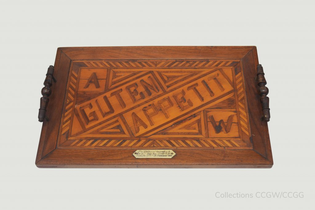A handcarved wooden tray made by a German prisoner of war held at Amherst Internment Camp.