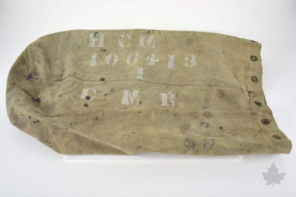 A photo of the kitbag of Private Hazelton Clifford Moore of the 1st CMR. Faded writing on the bag indicate his initials (HCM) as well as his regimental number (106413) and his unit (1 CMR)